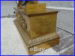 Ancienne et trés grande pendule bronze doré style Empire /restauration 19eme