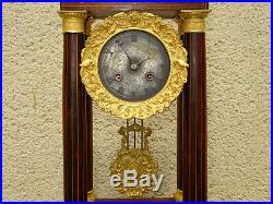 Ancienne pendule portique d'époque Charles X, Antique gilt clock