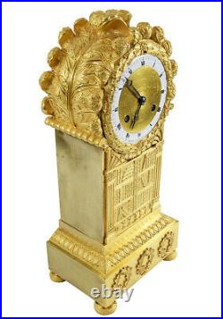 BIBLIOTHEQUE KINABLE. Kaminuhr Empire clock bronze horloge antique pendule uhren