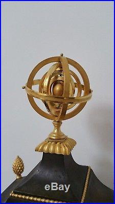 Belle pendule d'epoque Empire en bronze patiné et doré Sphere armillaire TTBE