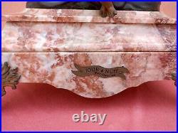 EXCEPTIONELLE PENDULE EN REGULE ET BRONZE XIXeme hauteur/76,5 cm