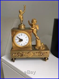 Exceptionnelle mini pendule bronze doré 19eme