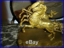 Exceptionnelle pendule char d'époque 1er empire en bronze doré au mercure