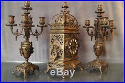 Garniture de cheminée pendule paire de candélabres bronze 19e style Louis 14