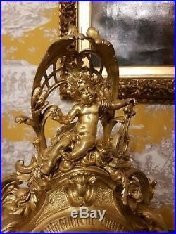 Grand cartel, pendule Louis XV Rocaille en bronze ciselé doré, époque 19ème