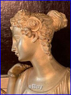 Grande pendule en bronze ciselé et doré d'époque Restauration à décor de Psyché