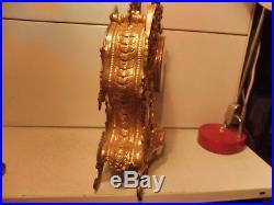 Grande pendulecartel bronze fonctionne sonne