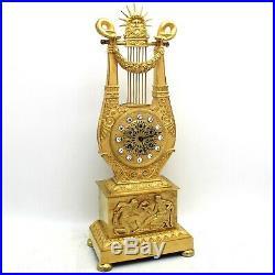 Horloge Pendule Lyre d'époque Empire en Bronze dorè du 19ème siècle