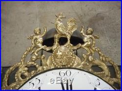 MECANISME D'HORLOGE COMTOISE AU COQ FLEURS DE LYS DU XVIII ème SIECLE