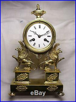 Magnifique horloge pendule empire en bronze massif mouvement a fils fonctionne