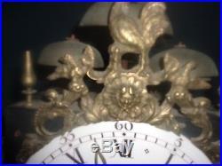 Mouvement de comtoise 4 cloches sonnerie des quarts tete et balancier