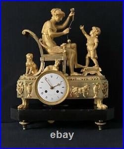 Pendule Empire La leçon de bilboquet en bronze doré. (French ormolu Clock)