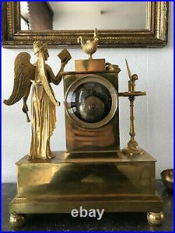 Pendule En Bronze Dorée Et Porcelaine, Époque Empire, Ange, Bon État