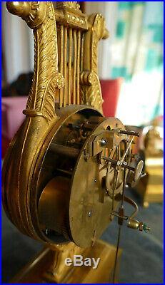 Pendule Lyre Empire en Bronze doré Signée sur cadran émaillé Ager à Avignon