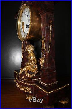 Pendule bronze doré au mercure et marbre XIX