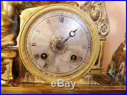 Pendule bronze dore mouvement a reparer