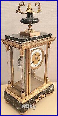 Pendule cage à colonnes en bronze marbre et cristal XIXeme