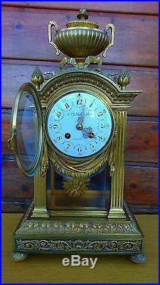 Pendule cage en bronze Louis XVI
