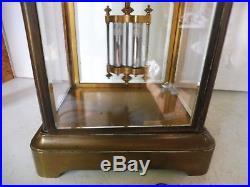 Pendule cage quatre verres bisautes echappement apparent fonctionne sonne
