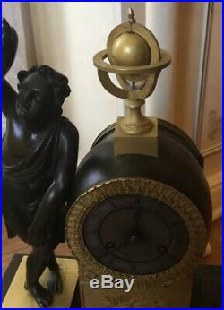Pendule empiré en bronze