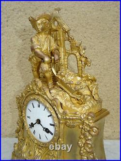 Pendule en bronze doré style rocaille dépoque Napoléon III