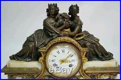 Pendule en marbre blanc et bronze
