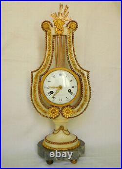 Pendule lyre d'époque Louis XVI en marbre et bronze doré Barancourt à Paris