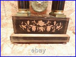 Pendule portique palissande, bois clair et laiton dore fonctionne sonne