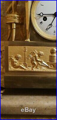 Rarissine pendule premiere empire en bronze dore