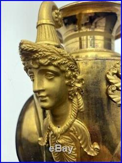 Superbe pendule Empire bronze doré forme vase