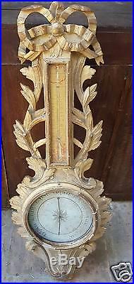 Très beau baromètre et thermomètre Louis XVI, bois doré à l'or fin